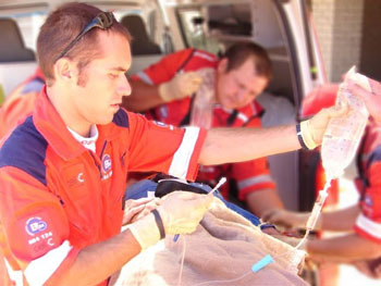 Image: A paramedic preparing an intravenous infusion for a patient (Photo courtesy of Werner Vermaak).